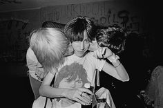 Patti Smith gets a kiss from Iggy Pop and James Williamson of the Stooges, photoMichael Ochs1975