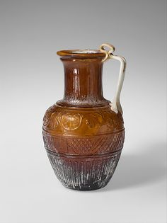 Glass jug  Period: Early Imperial, Julio-Claudian Date: 1st half of 1st century A.D. Culture: Roman Medium: Glass; blown in a four-part mold