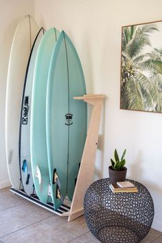Surfboard racks support our beloved surfboards so they deserve to be awesome. Here are 12 of the coolest surfboard racks we've ever seen. Surfboard Storage, Surfboard Rack, Surfboard Decor, Surf Decor, Surf Style Decor, Foam Surfboard, Decoration Hawai, My New Room, My Room