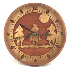 """This handmade wooden wall #clock """"Riding Cowboys"""" is sure to be a great addition…"""