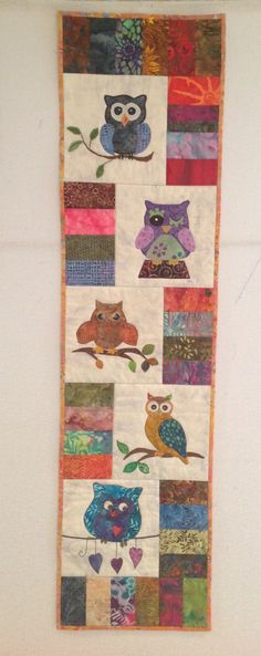 Owls Quilt made for Naomi who is moving to NC from FL.  We will miss her so much, the Tuesday Night Owls Bee will not be the same without Naomi.  The 5 of us each made one owl block and then assembled it in a wall hanging.  May 2015