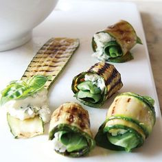 zucchini rollups...grilled zuchinni strips with goat cheese and fresh basil leaves