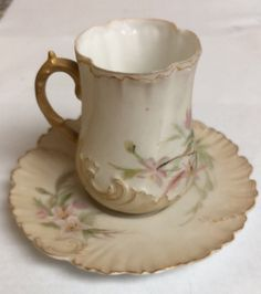 BEAUTIFUL Delicate Limoges France Scalloped Teacup & Saucer - $34.99. Up for auction is a beautiful and delicate French tea cup with matching saucer! When I first laid eyes on it over 25 yrs ago, I thought it was RS Prussia! I am liquidating my entire collection of antiques and collectibles as I prepare to move so please keep checking back on my auctions! The tea cup measures two and three-quarter inches tall and the saucer is 4 1/4 inch in diameter. I can find no chips or repairs on...