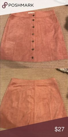 NWOT BUTTON UP SUEDE SKIRT Such a cute orangey-brown button up suede skirt!!! never worn and in great condition Blush Skirts Mini