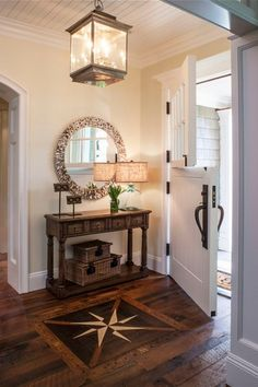 Cottage Entryway with Northeast lantern concord pendant, Covered storage basket, Standard height, Hardwood floors, Dutch door