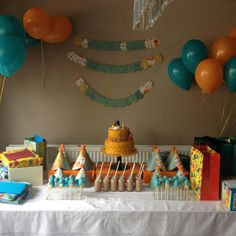 Pingu cake. Birthday table layout. Orange & teal theme. Penguin cake pops.  Miniature milk bottles & old fashioned paper straws. Lexxs' colours will be icy blue and brown.