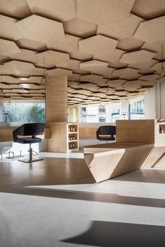 dezeen — Hexagonal-patterned ceiling added to Paris hair...