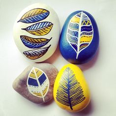 """""""04. What's heavier - a ton of feathers or a ton of rocks? The juxtaposition of the weightless feather painted on a heavy stone makes this idea really fun.…"""" ROCK ART! Painting on Rocks, Stones and pebbles - by Denise Scicluna http://www.amazon.co.uk/Rock-Art-Painting-Crafting-Humble/dp/1438005326"""