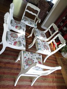 Duncan Phyfe style dining chairs painted in Annie Sloan Old White chalk paint, distressed then clear wax.