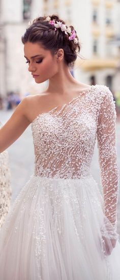"""""""One shoulder long sleeve Rubina gown accented with intricate pearl detailing a line wedding dress and sweeping train will make your look unforgettable #weddingdress #weddinggown #bridedress"""
