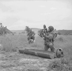 Airborne soldiers retrieve folding motorcycles or 'Welbikes' from equipment containers Bulford 9 June 1943.