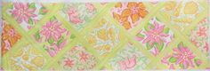 Patchwork of Lilly-inspired Patterns with Lattice - Long Rectangle in Yellows, Pinks & Corals  8 x 24, 13 mesh