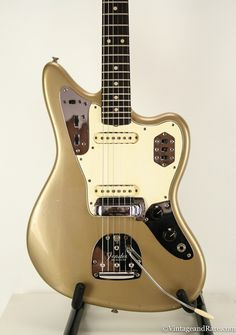 Absolutely stunning, 100% original Pre-CBS custom colour 1964 Vintage Fender Jaguar in ultra-rare original Shoreline Gold with matching headstock! Shoreline Gold is an absolute top-tier fender custom
