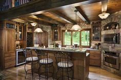 rustic stone wall and curved panty door.  rustic planked ceiling. Would like to see round log beams.
