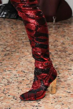 Emilio Pucci's slinky knee-high boots with a graphic energy