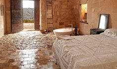 Sextantio Le Grotte: Romantic candlelit rooms are carved out of rock at this stunning cave hotel in Sassi di Matera. This is interesting, a hotel in a cave dwelling in Italy! Rustic Italian Decor, Gite Rural, Cave Hotel, Italy Holidays, Southern Italy, Best Hotels, Home Remodeling, Bedroom Decor, Bedroom Ideas