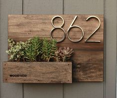 This house number planter box makes the perfect addition to any front porch. We start by staining poplar wood a Dark Walnut color and seal it well with a water based, satin finish polyurethane. Three holes are drilled into the bottom of the planter box se Wooden Table Diy, Table En Bois Diy, Diy Table, Diy Wood, Wood Crafts, Paper Crafts, Succulents, Succulent Plants, Succulent Boxes