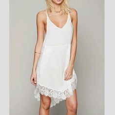 FREE PEOPLE NWT WHITE ASYMMETRICAL LACE SLIP DRESS FREE PEOPLE NWT WHITE ASYMMETRICAL EYELASH LACE SLIP DRESS! 💯% Authentic. NWT! Gorgeous lace trimmed slip dress is great for layering with lace peaking out & great own her own. In alabaster which is basically white. Versatile color/style, a 5 star favorite. Better than pix. In small but not too big on XS, so both XS & S. New with tags. First Quality. Perfect condition. Bundle for a discount. Free People Dresses Asymmetrical