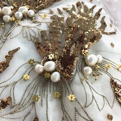 On the cutting table - White organza tunics with gold leaves sprinkled with French florets and semi precious cream pearls - #MuseLuxe Details #SummerLove