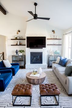 brick fireplace, graphic rug, beams, leather