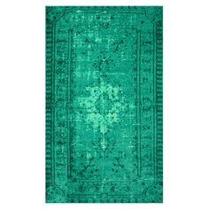 Add a pop of pattern to your living room or den with this artfully crafted rug, showcasing a distressed Persian-inspired motif in turquoise.  ...