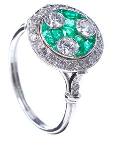 Art Deco Three Stone Diamond & Emerald Ring, Three Old European cut diamonds weighing ~0.70 cts total set in a bed of calibrated cut emerald with a round diamond border of ~0.30 cts in platinum fancy setting. United States, Art Deco.