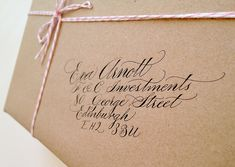 nice traditional calligraphy with beautiful baker's twine detail.  by Claire Gould of Calligraphy for Weddings (calligraphystore on Etsy)