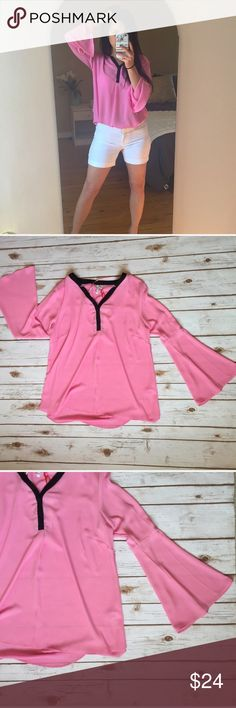 """Pink Sheer Bell Sleeve Blouse Pretty pink blouse trimmed in black with flowy bell sleeves. Material is sheer. Could be worn tucked in or out. Lightweight.  Brand new with tags.  Measurements (taken lying flat): 24.5"""" length front 27"""" length back 23"""" sleeve 19.5"""" bust  Materials: 100% polyester  🚫Trades Elle Tops Blouses"""