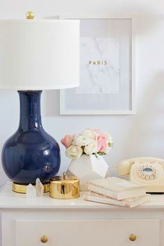 This elegant blue lamp breaks up a neutral bedside table