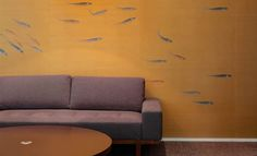 Transient fish on bold metallic background by Misha handmade wallpaper