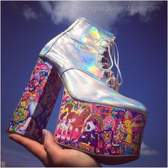 They were FEATURED ON LANA DELRAYS Insta! Mega platform wedge glitter leather ankle boots with your favorite iconic 90s stickers! Glitter leather uppers with bold hand collaged sticker wood platforms. Simply gorgeous, sticker collage is fully sealed, extremely high quality all professional materials used. Completely customizable in your size and glitter color as well as chunky heel or wedge.