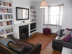 Wrong furniture/colour but like the tv within the alcove shelving