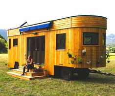 This unique example of a tiny house on wheels comes to us from Austria, and is made by Wohnwagon. It shows off an exterior clad in larch, with a rounded end that gives it a certain visual appeal. Wohnwagon brings a sustainable approach to the build, using locally sourced and recycled materials, and finishing it... View Article