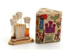 A 'Castle' presentation of 'Mon Image', 'Tailspin', 'Lilac', and 'Honeysuckle' perfumes for Lucien Lelong, in glass bottles, with plastic castle and display box. c1940