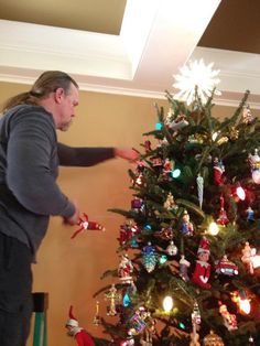Trace decorating his tree.
