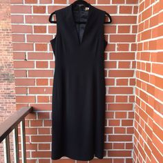 J Crew Black Sleeveless Wool Dress Classic black sleeveless dress with zip up back. 95% wool, 5% spandex, perfect for any season.  Love the classic silhouette, just a timeless addition to your wardrobe. In excellent condition. Enjoy! J. Crew Dresses Midi
