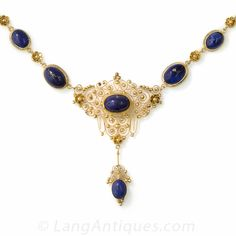 15K Lapis Necklace. Richly bloomed 15k yellow gold has been hand fabricated to form one of the most lovely and lacy filigree necklaces we currently have in our collection. Tendrils, scrolls, coils and tiny rosettes are woven around bezel-set, cabochon-cut, lapis lazuli ovals, to form a neck-piece which could easily become one's signature piece.