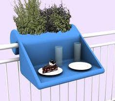 not sure I will have a railing or a need for one, but this is a great idea for breakfast on little balcony spots