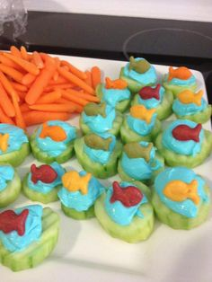 Greek Yogurt Cream Cheese and Blue Food Coloring...colored gold fish on a cucumber.