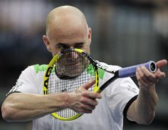 Tennis legend Andre Agassi doles out some advice to Canadian Milos Raonic.