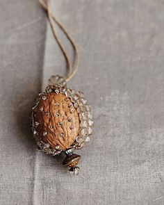 Make an unusual bejeweled walnut pendant to give or keep with this inventive DIY.