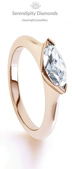 Sideways set Marquise cut diamond solitaire engagement ring. Breathtakingly beautiful and streamlined with slender proportions. The open sides allow light to flood through the diamond, skilfully set above a comfortable court shaped band.