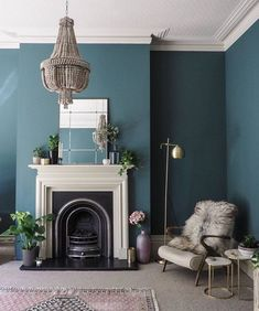 Living room painted in Inchyra Blue, ceiling in Shaded White and the fire surrou. Living room painted in Inchyra Blue, ceiling in Shaded White and the fire surround in Drop Cloth.