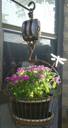 Another cool idea made from a vintage pulley, & a wire pot holder & plant
