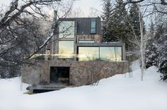 LA MUNA  What's not to love about 'La Muna', a complete renovation and minor addition of one of the first homes built in the exclusive enclave of Red Mountain in Aspen Colorado. Oppenheim Architects used reclaimed regional wood, stone and steel to make a minimal impact on the natural resources and merge the home effortlessly with its idyllic surroundings of forest, stream and mountain.