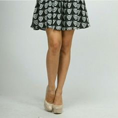 BLACK LEOPARD SKIRT ($45) Let me know what size you want and I will create a separate listing for you. black and white skirt with leopards. Perfect with tights and a jacket. Moon Collection Skirts