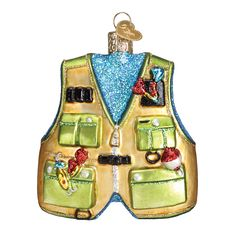 The fishing vest is essential apparel for a fisherman wading in the water. The vest allows the angler to have tools, tackle and more all within arm's reach. A fisherman's catch-of-the-day tales are notorious for growing in the imagination as time passes. Celebrate the fisherman or woman in your life with the fishing vest ornament. #fishing #fishingvest #fishermen #fisherwoman #catchoftheday #fishingtales #fish #glassornament #oldworldchristmas  Fishing Vest (Item #44091) New! Bestseller!