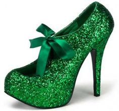 Coveredin green glitter with a grosgrain bow closure, these are just plain fun. Pleaser Bordello Shoes are known for their vintage-styled shoes, affordable prices and are a favorite in the rockabilly and burlesque worlds. These glittery fun shoes also come in black, pink, blue, red, purple and gold and can be found online at many vintage-inspired sites.