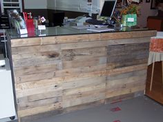 We made our retail counter using old pallets.  It's one of the first things you see when entering the gallery and makes quite a statement.