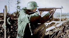 SS soldier shooting with maschinenpistole
